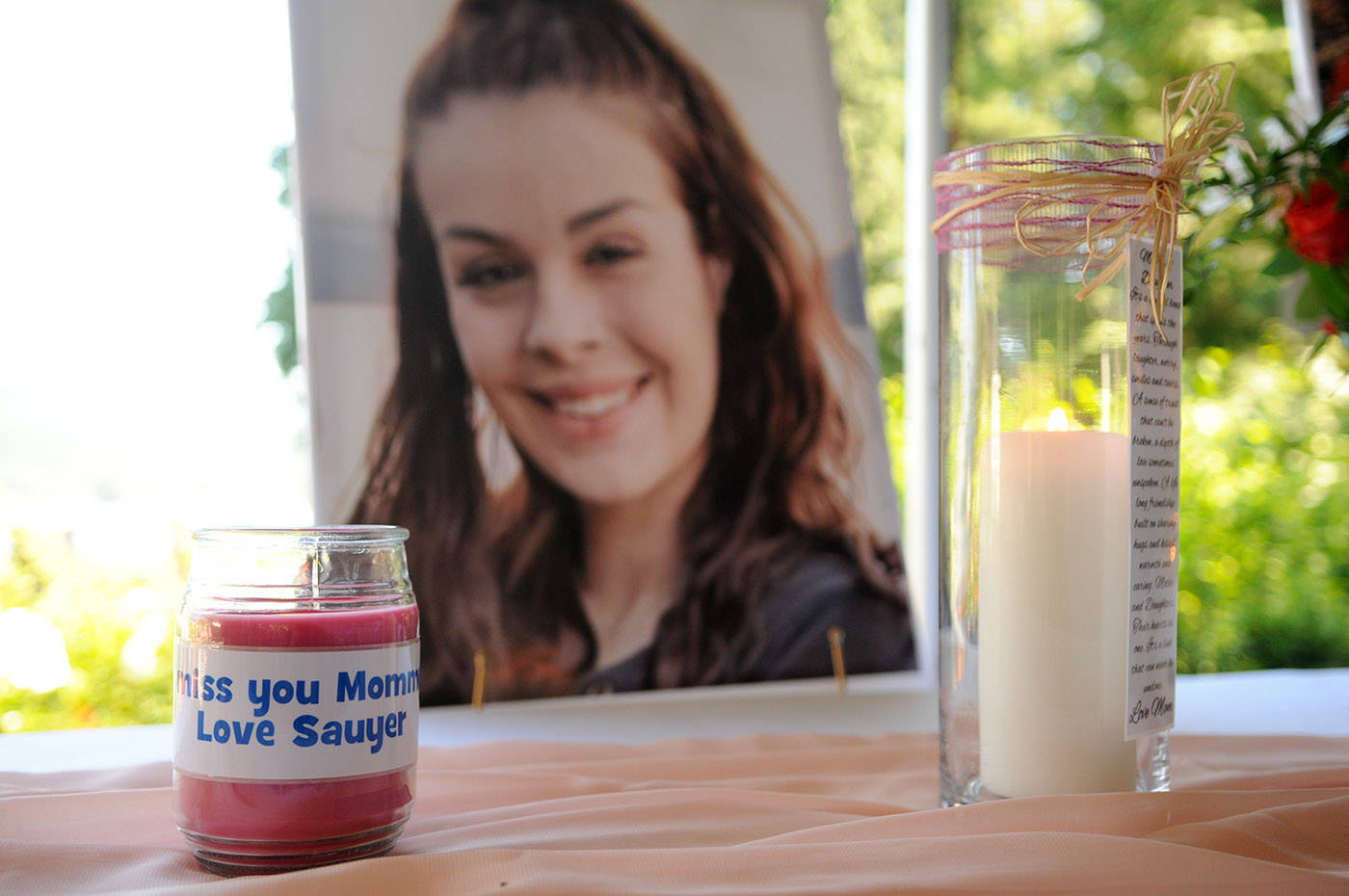 Candles with messages from Shaelene Bell's two boys were lit during her celebration of life at Sandpiper Resort on Saturday, June 26, 2021. (Jenna Hauck/ Chilliwack Progress)