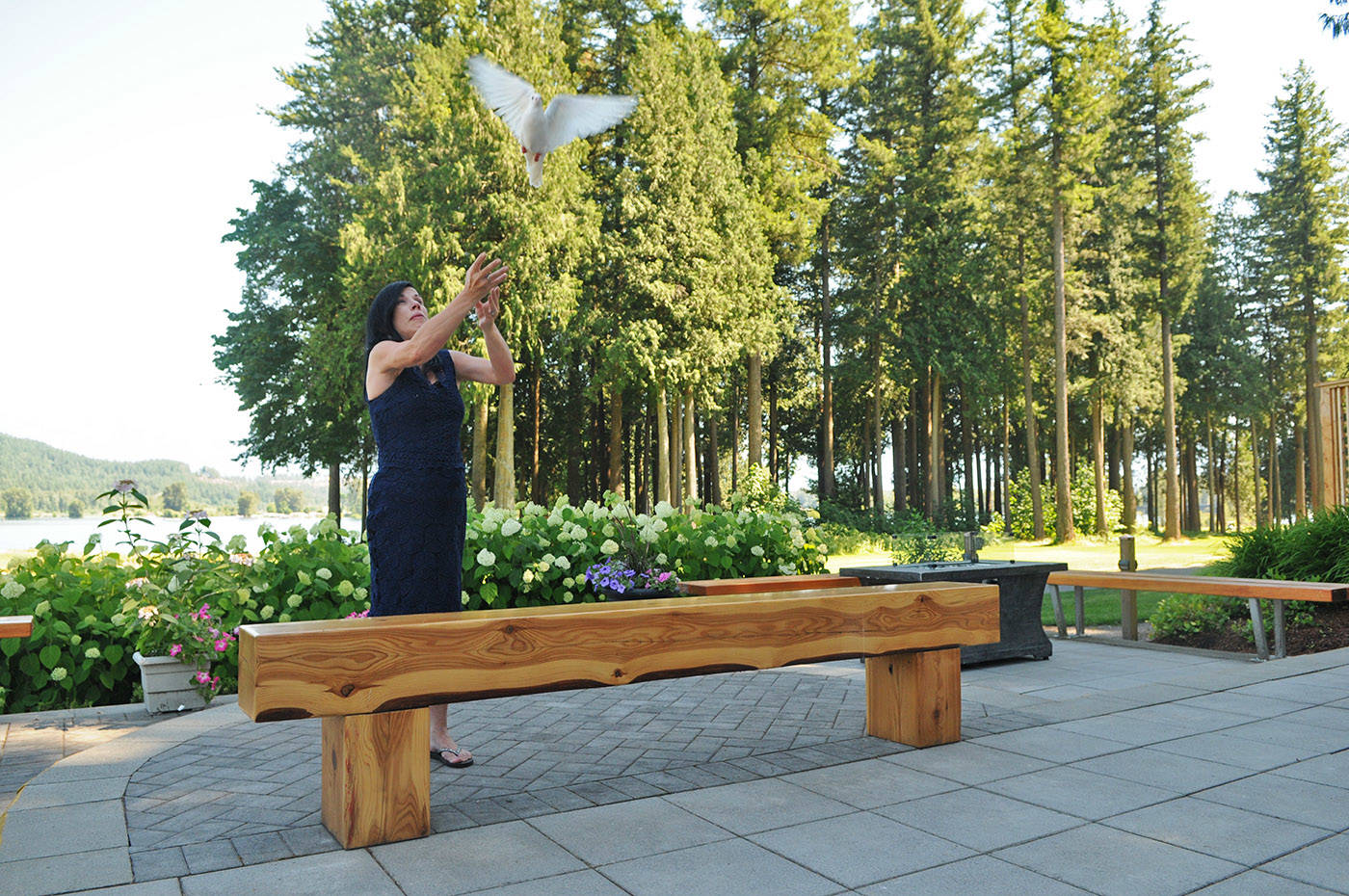 Alina Durham, mother of 23-year-old Shaelene Bell, releases a dove during her daughter's celebration of life at Sandpiper Resort on Saturday, June 26, 2021. (Jenna Hauck/ Chilliwack Progress)
