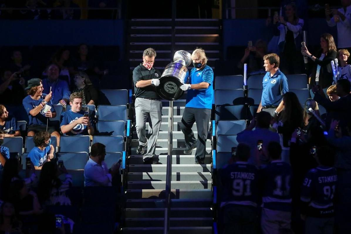 The Stanley Cup is carried down to the ice at Amalie Arena as fans look on in Tampa, Fla., Tuesday, Sept. 29, 2020. THE CANADIAN PRESS/AP-Tampa Bay Times, Dirk Shadd