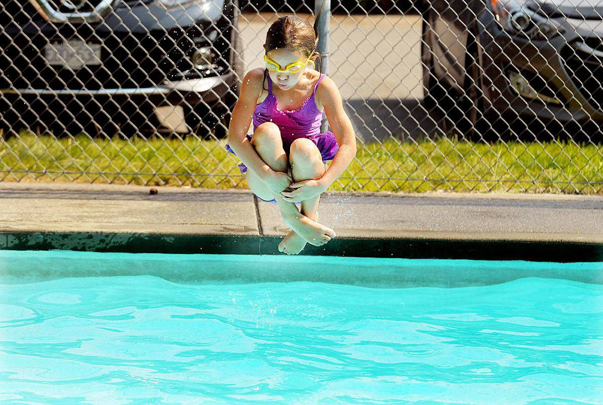 A young swimmer takes a dives at the Fort Langley outdoor pool in 2017. (Langley Advance Times file)