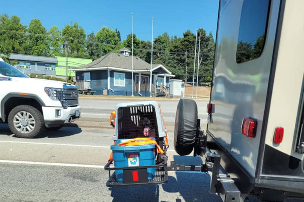 Residents across B.C. were infuriated and horrified after photos of a dog being carried in a crate behind an RV in the Interior during the province's record breaking heatwave were posted to social media Sunday June 27, 2021. (Heather Peters/Facebook)