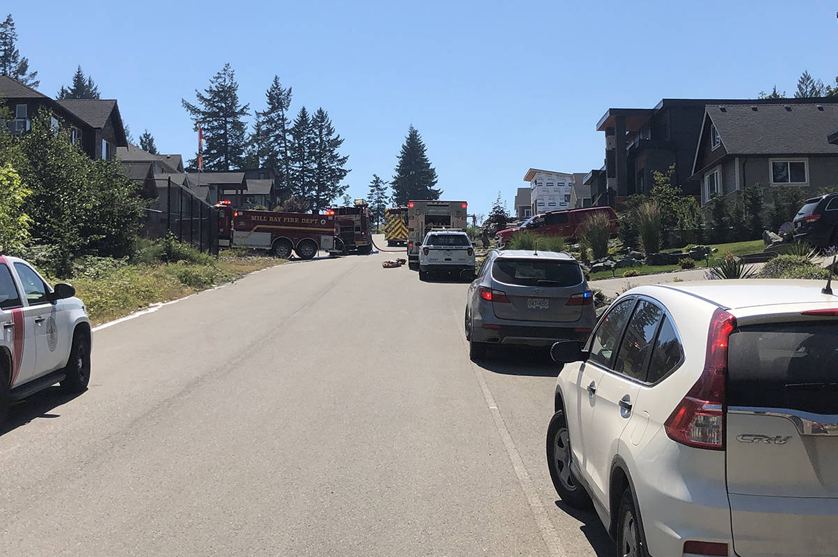 Rescue crews remain at the scene of a small plane crash in Mill Bay Monday afternoon, June 28, 2021. (Kevin Rothbauer/Citizen)