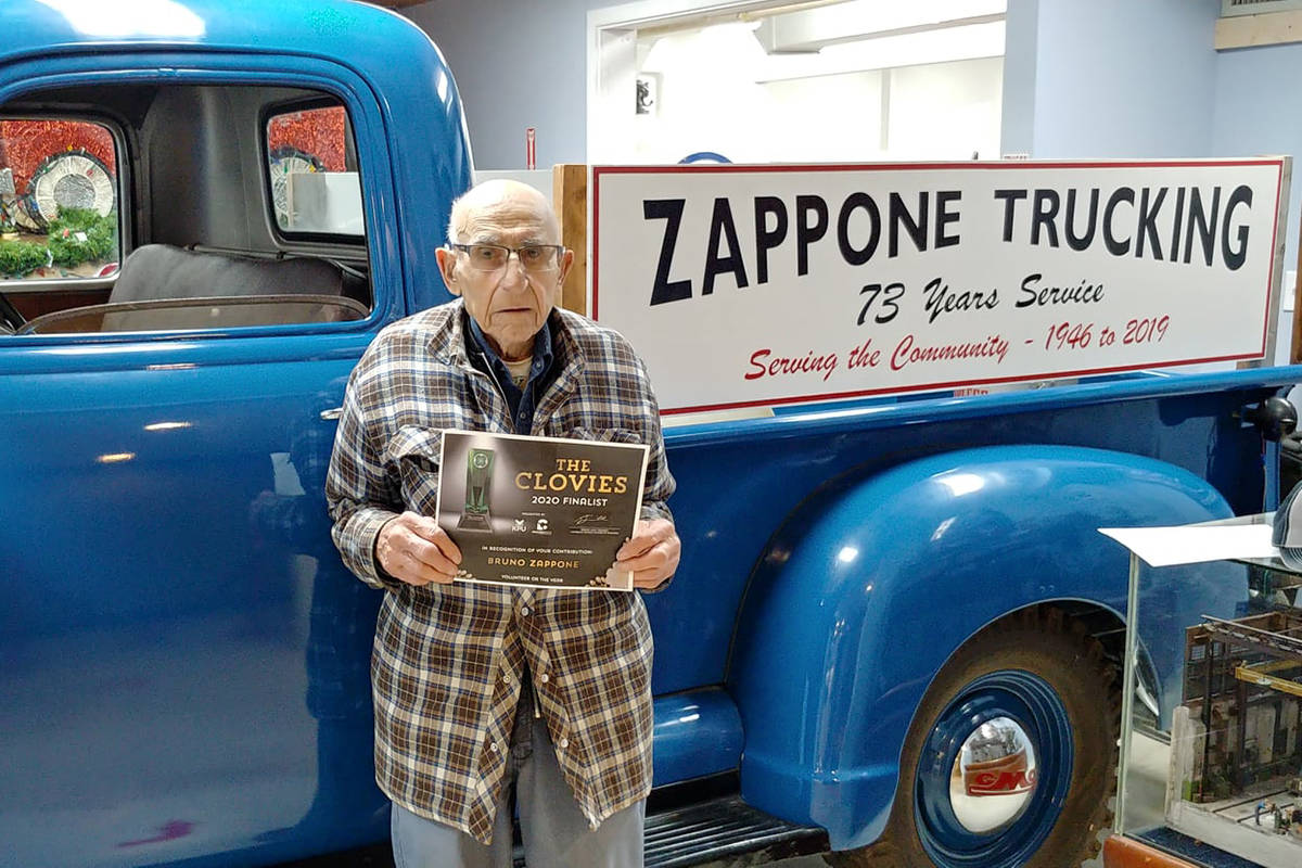 """Bruno Zappone, then the oldest volunteer at the B.C. Vintage Truck Museum, receives a 2020 Clovie for """"Volunteer of the Year"""" from the Cloverdale District Chamber of Commerce on Dec. 6, 2020. Zappone passed away June 22 at the age of 95. (Image via Facebook)"""