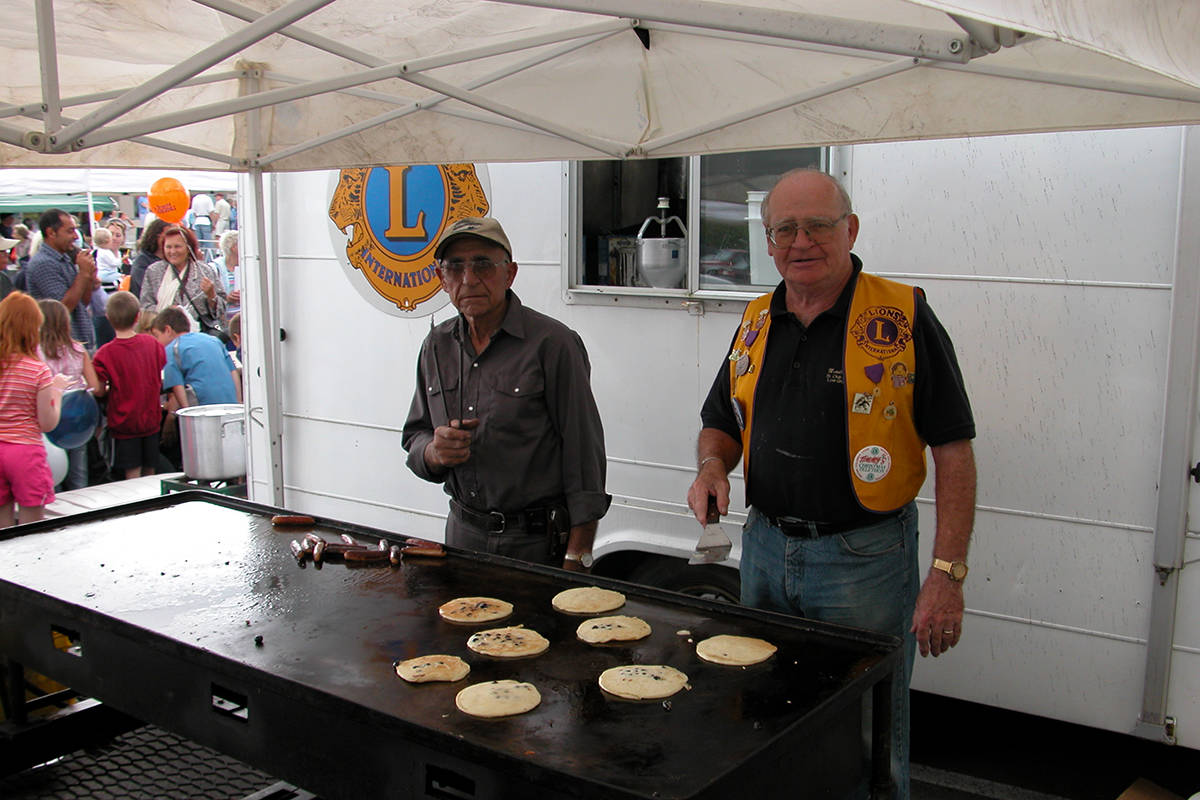 Bruno Zappone (left) cooks breakfast with a fellow Lions Club member during the 2006 Blueberry Festival. (Image submitted: Paul Orazietti)