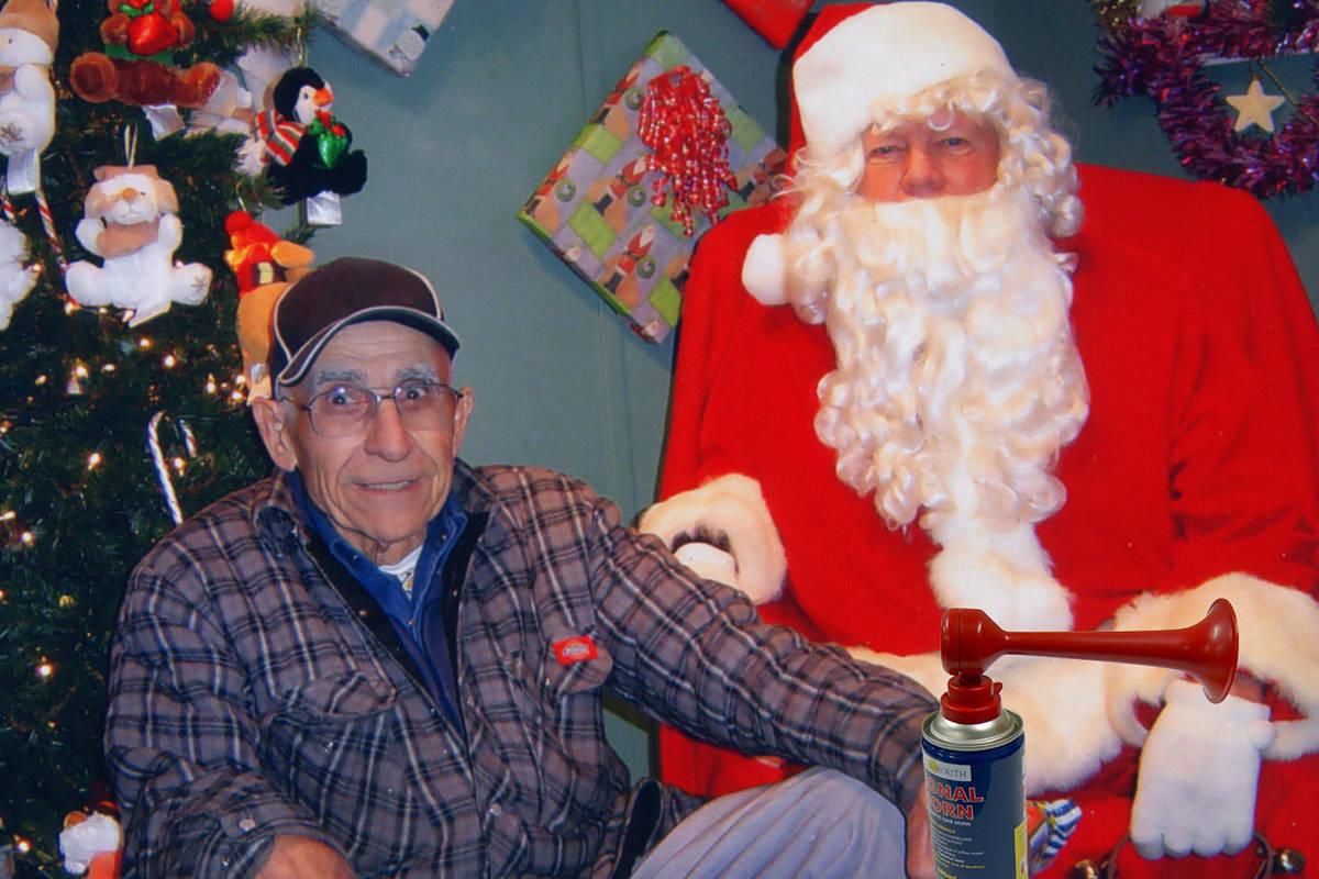 Bruno Zappone sits with Santa in the Santa Hut at Clover Square Village in 2018. (Image submitted: Paul Orazietti)
