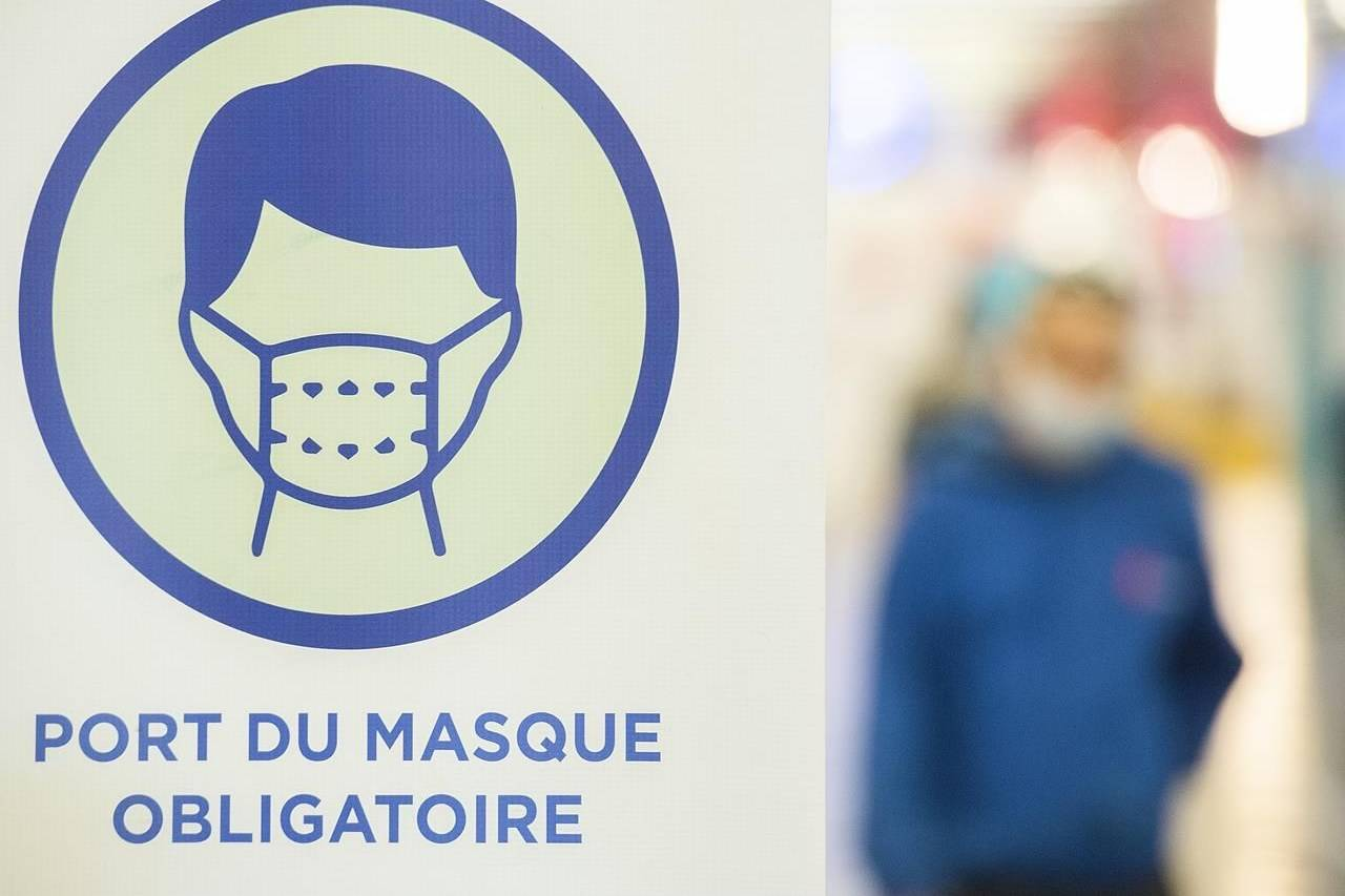 A sign advising mandatory wearing of masks to prevent the spread of COVID-19 is shown in Montreal on Saturday, June 19, 2021. THE CANADIAN PRESS/Graham Hughe