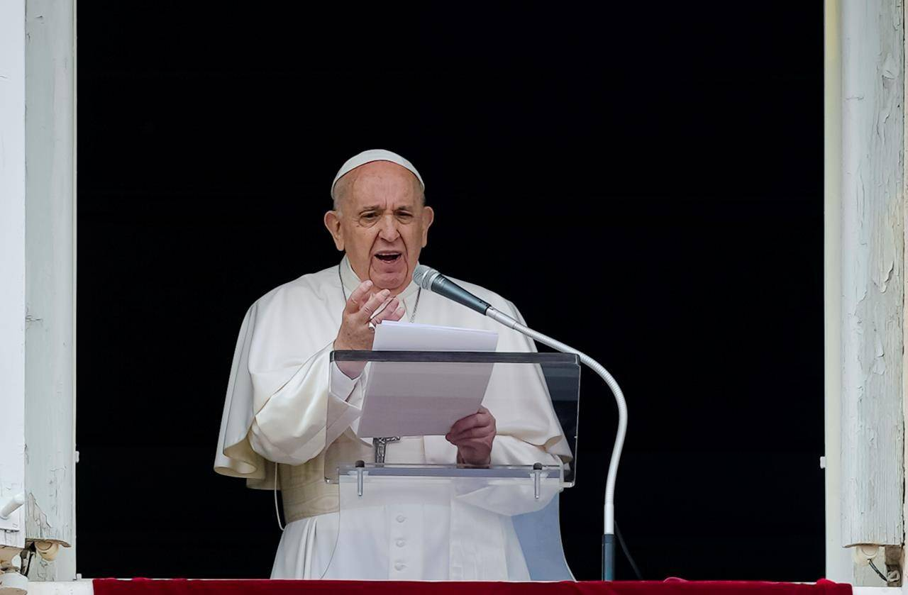 Pope Francis speaks from the window of his studio overlooking St. Peter's Square at The Vatican to a crowd of faithful and pilgrims gathered for the Sunday Angelus noon prayer, on June 6, 2021. THE CANADIAN PRESS/AP, Domenico Stinellis