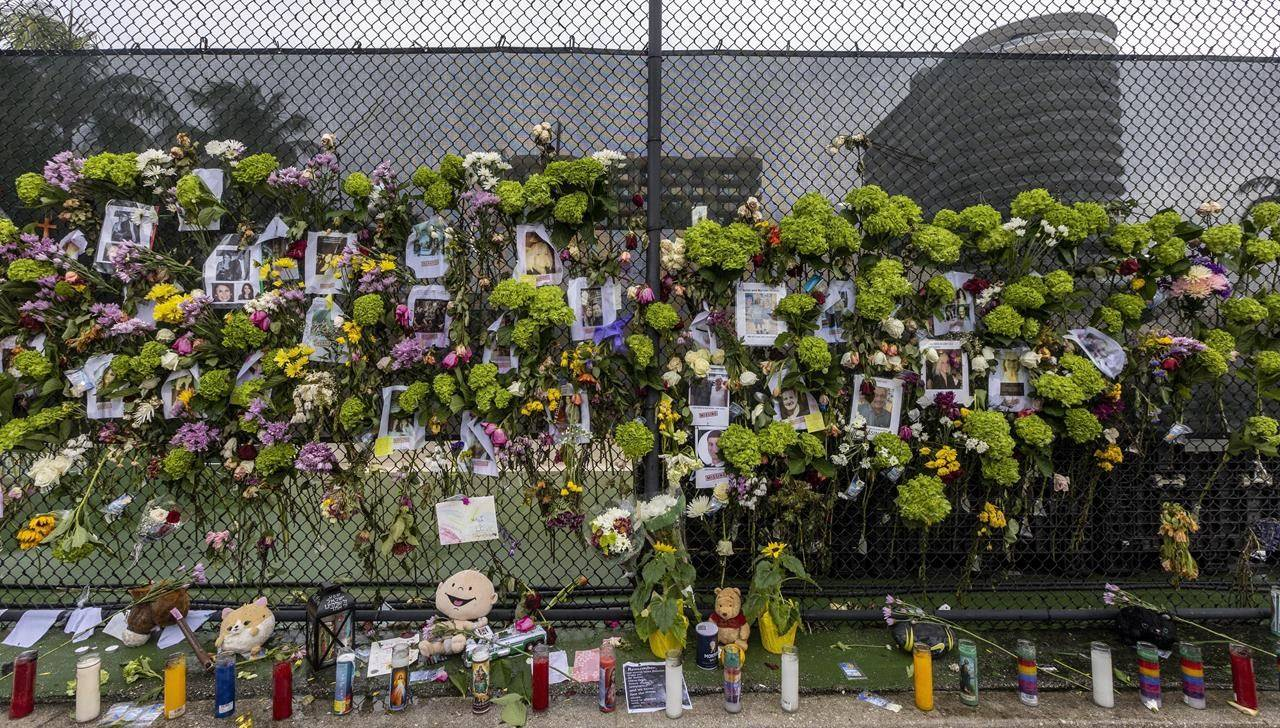 A makeshift memorial is set up near the site of the collapsed condominium in Surfside, Fla., Monday, June 28, 2021. (Jose A Iglesias/Miami Herald via AP)