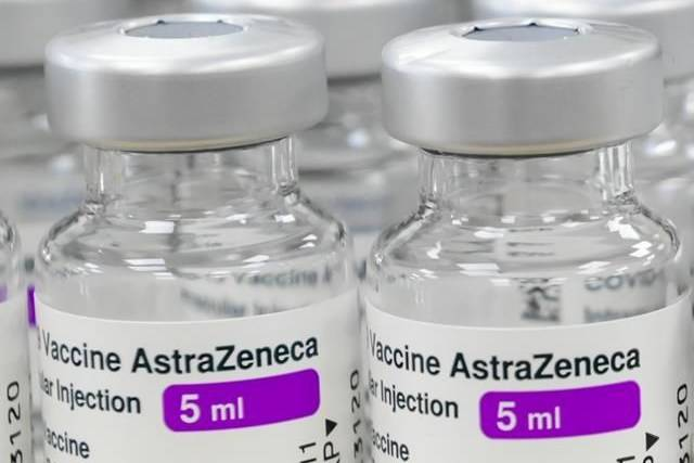 Vials of both Pfizer-BioNTech and Oxford-AstraZeneca COVID-19 vaccines sit empty on the counter at the Junction Chemist Pharmacy, in Toronto, Friday, June 18, 2021. THE CANADIAN PRESS/Nathan Denette