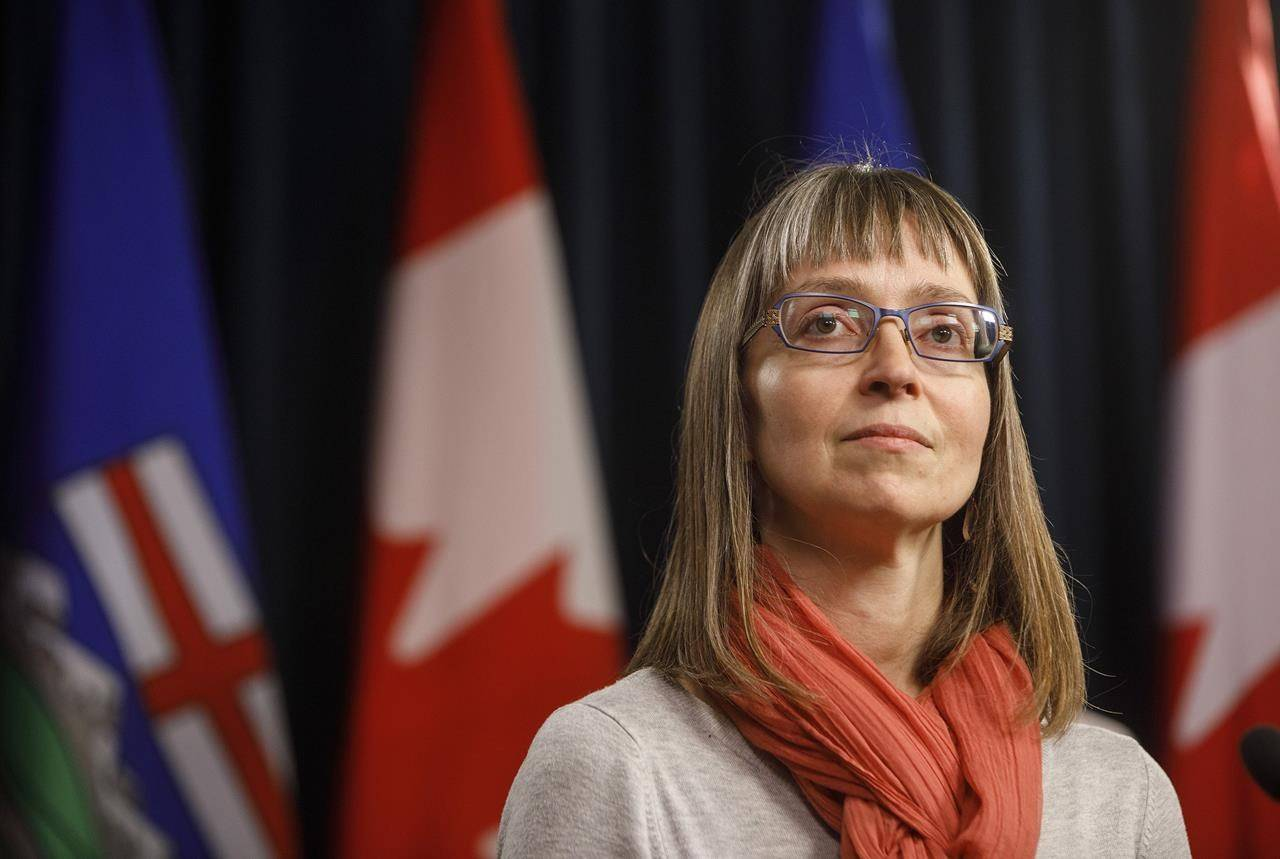 Alberta's chief medical officer of health, Dr. Deena Hinshaw, updates media on the COVID-19 situation in Edmonton on Friday, March 20, 2020. She says COVID-19 numbers continue to fall but the plan is to remain vigilant as the province prepares to fully reopen Thursday. THE CANADIAN PRESS/Jason Franson