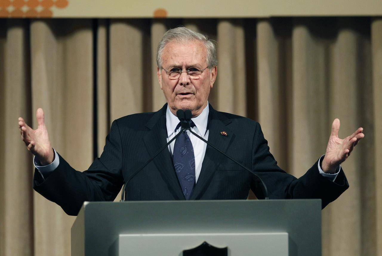 FILE - In this Oct. 11, 2011, file photo, former U.S. Secretary of Defense Donald Rumsfeld speaks to politicians and academics during a luncheon on security in rising Asia, in Taipei, Taiwan. (AP Photo/Wally Santana, File)