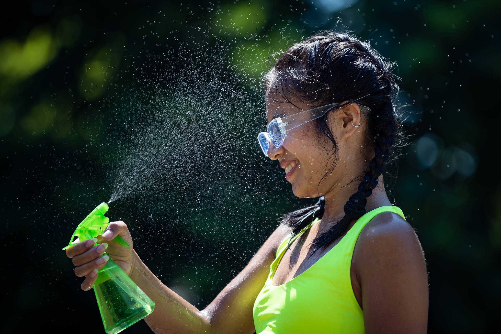 Leanne Opuyes uses a spray bottle to mist her face while cooling off in the frigid Lynn Creek water in North Vancouver, B.C., on Monday, June 28, 2021. Environment Canada warns the torrid heat wave that has settled over much of Western Canada won't lift for days, although parts of British Columbia and Yukon could see some relief sooner. THE CANADIAN PRESS/Darryl Dyck