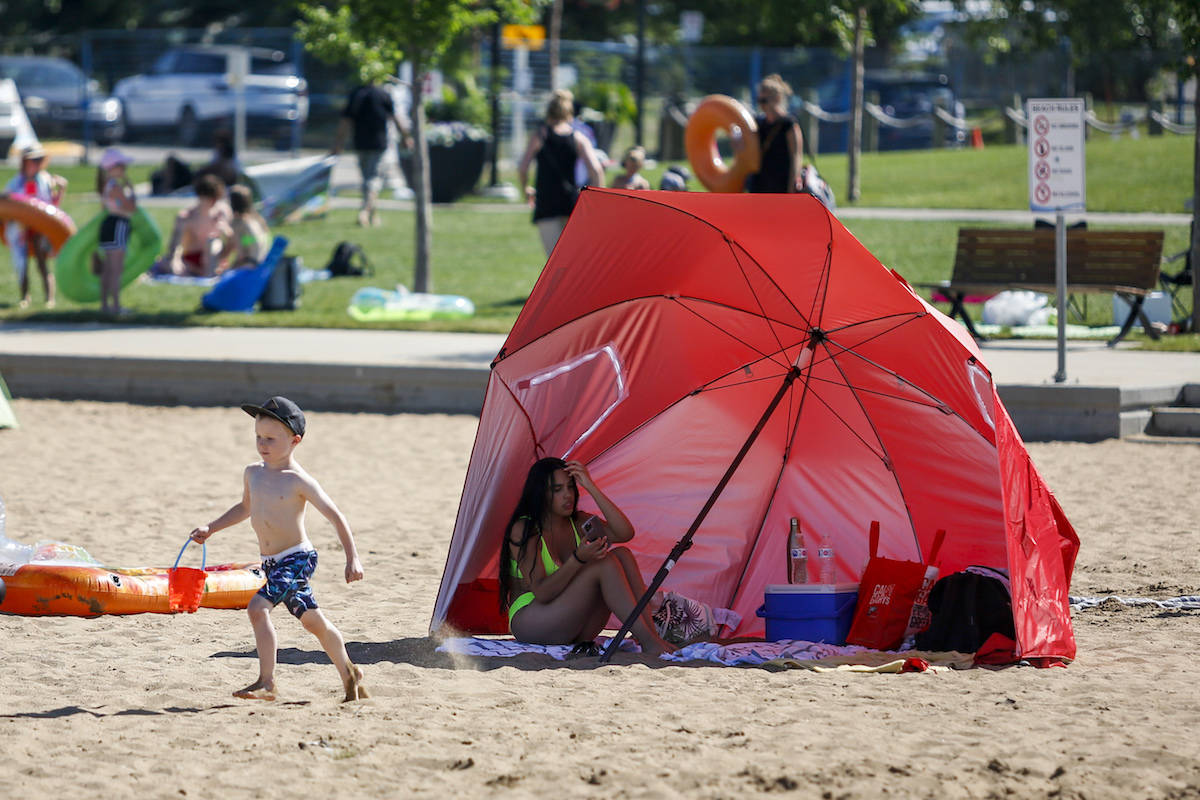 People try to beat the heat at a beach on June 30, 2021. THE CANADIAN PRESS/Jeff McIntosh