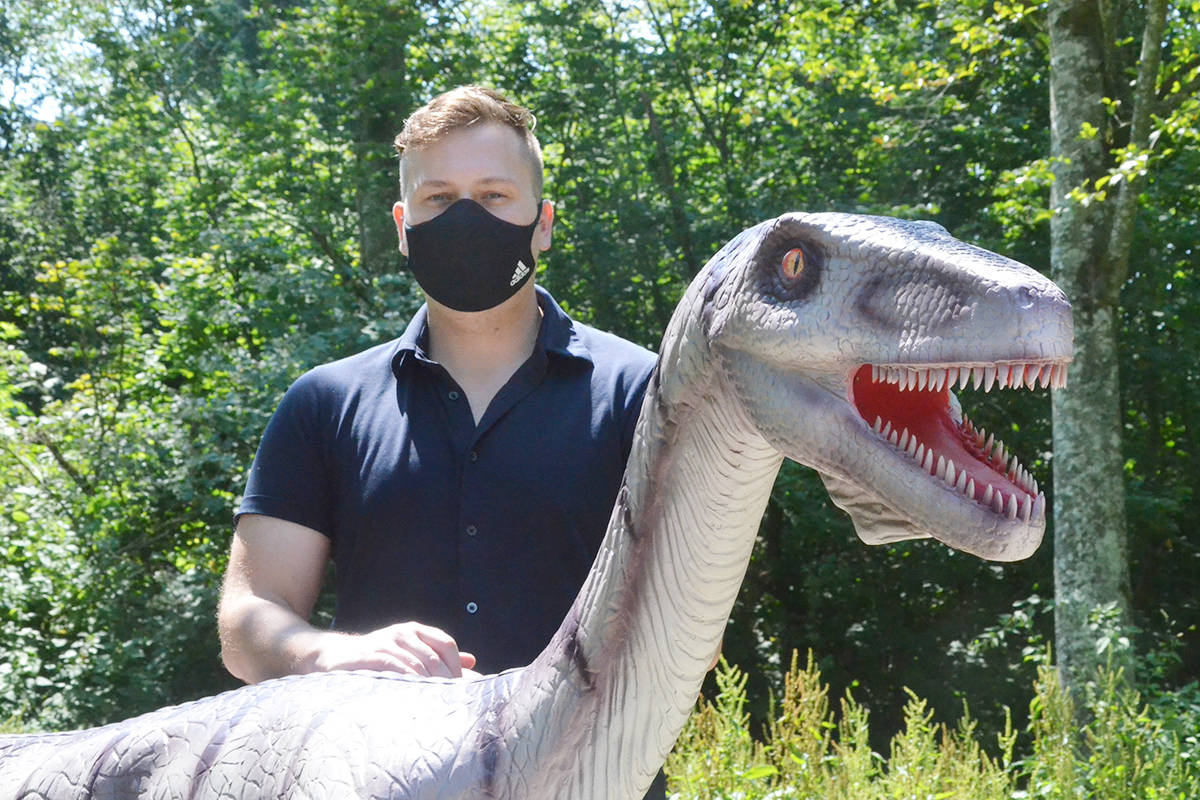 Greater Vancouver Zoo marketing manager Cody Gampe shows off a Coelophysis, a dinosaur that's part of the new Mesozoic Adventure. (Matthew Claxton/Black Press Media)