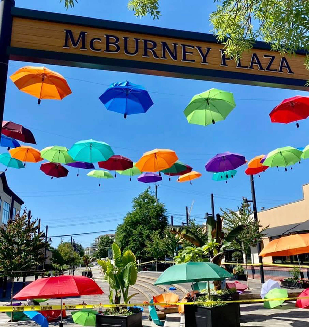 Hundreds of colourful umbrellas have been strung up over McBurney Plaza as part of a temporary outdoor art installation executed by the City of Langley. (Heather Colpitts/Langley Advance Times)