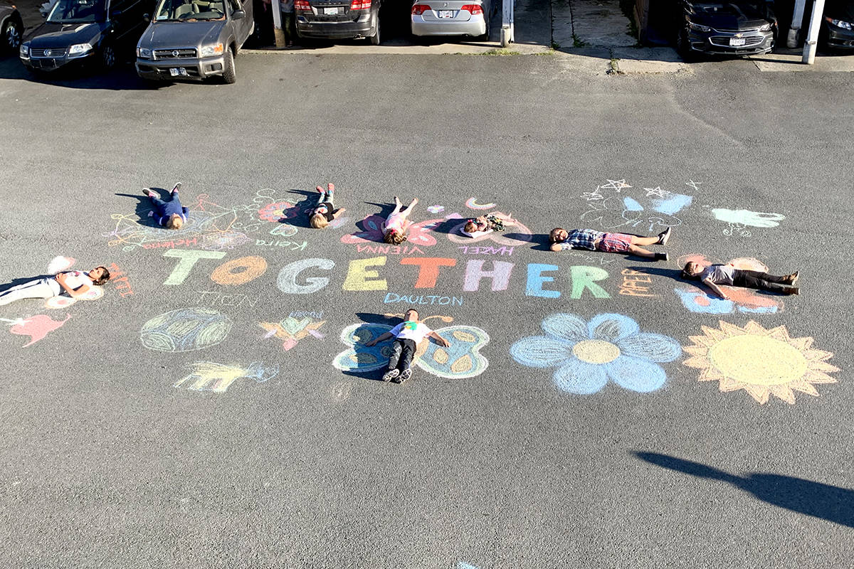 Ally Gallagher's chalk submission of the children in her neighbourhood working together is the winner of a chalk drawing contest that was open to Aldergrove residents. (Special to The Star)
