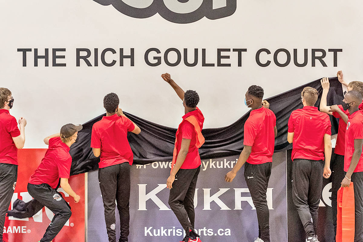 """International prep team players unveiled """"The Rich Goulet Court"""" in honour of the late, legendary Pitt Meadows basketball coach at the opening of the new Panther Hoops Basketball Academy facility in Langley. (Keith Daley/Special to Langley Advance Times)"""
