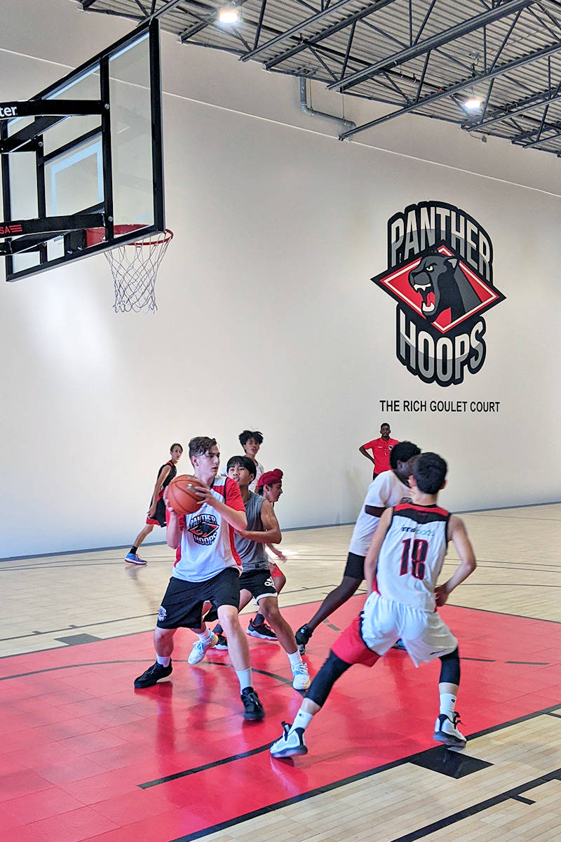 """""""The Rich Goulet Court"""" in honour of the late, legendary Pitt Meadows basketball coach was unveiled at the opening of the new Panther Hoops Basketball Academy facility in Langley. (Tracy Green/Special to Langley Advance Times)"""