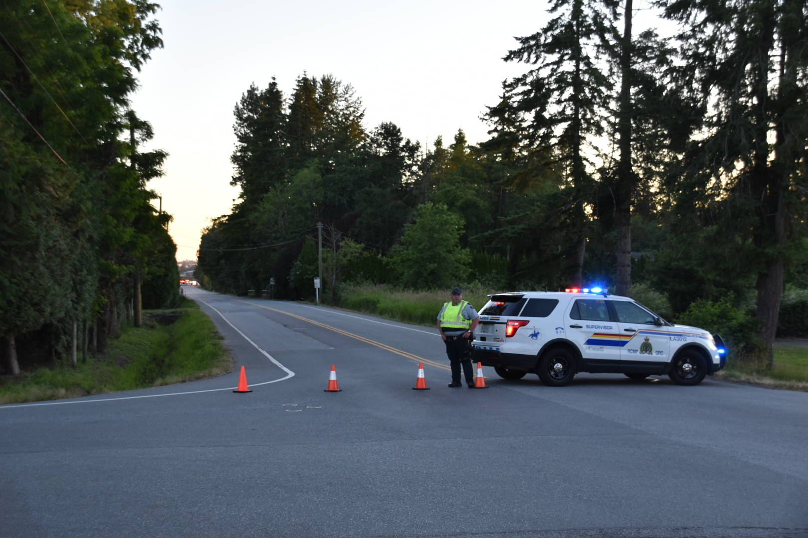 First responders were called to a single-vehicle crash in the 21900 block of 56th Avenue in the Murrayville neighbourhood on June 23, 2021 around 8:45 p.m. The two occupants in the vehicle were taken to hospital, one of which was a two-year-old boy, who remains in critical condition. (Curtis Kreklau/Special to Langley Advance Times)