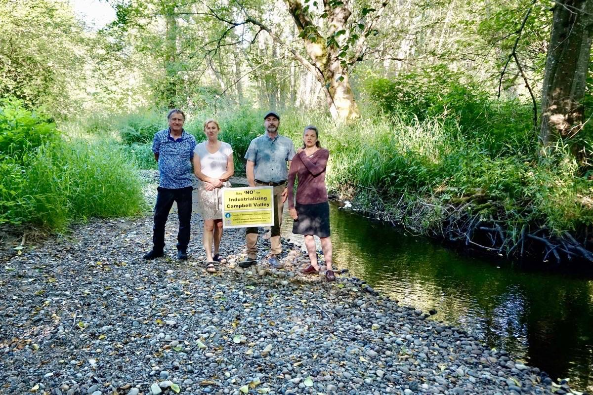 Stewards of the Little Campbell River and surrounding area (from left) David Riley, Sarah Rush, David Anderson and Shauna Anderson stand by salmon spawning grounds, just north of 16 Avenue in South Surrey. (Contributed photo)