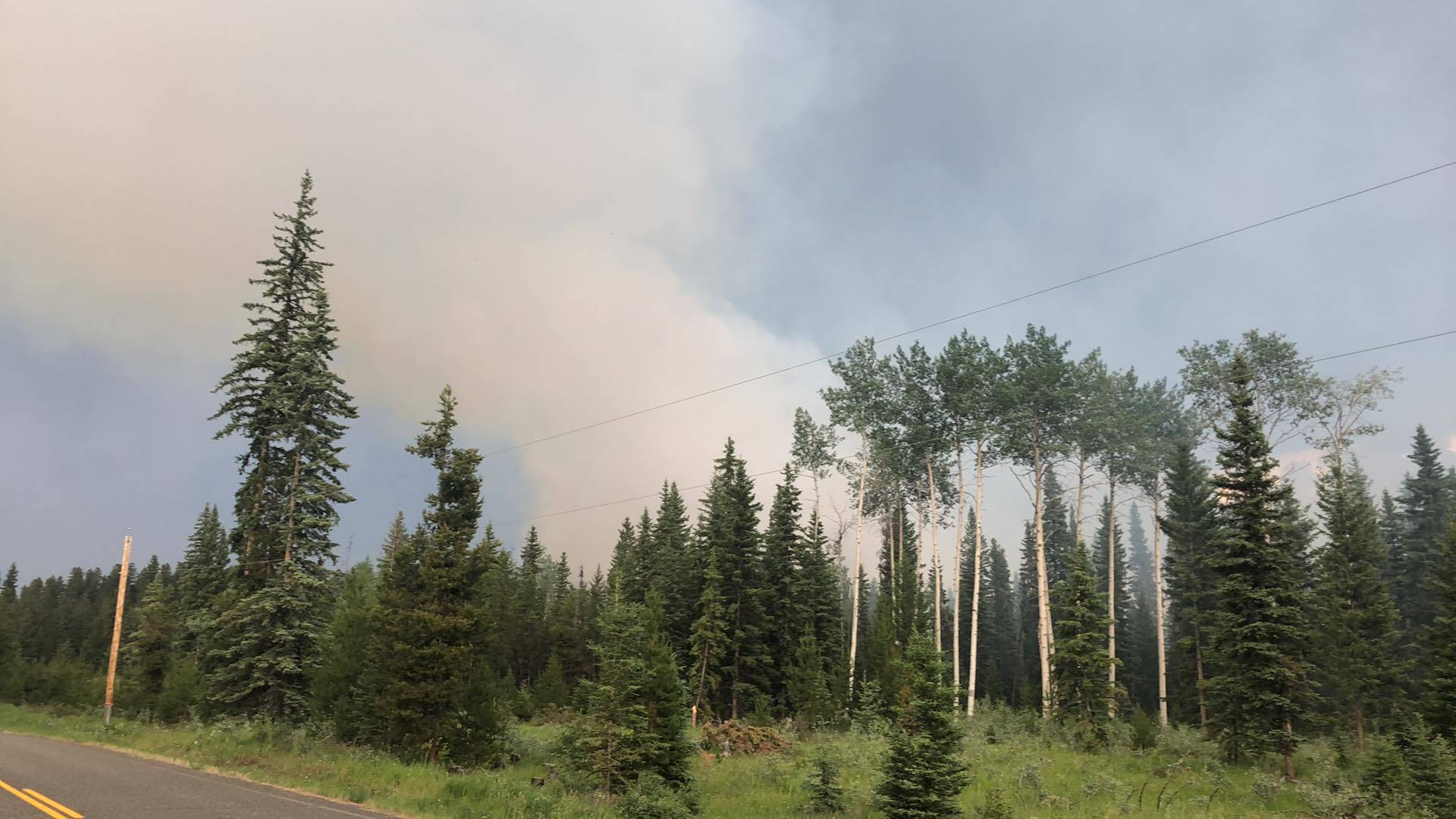 Smoke from a fire on Watch Lake Road (Patrick Davies photo-100 Mile Free Press)
