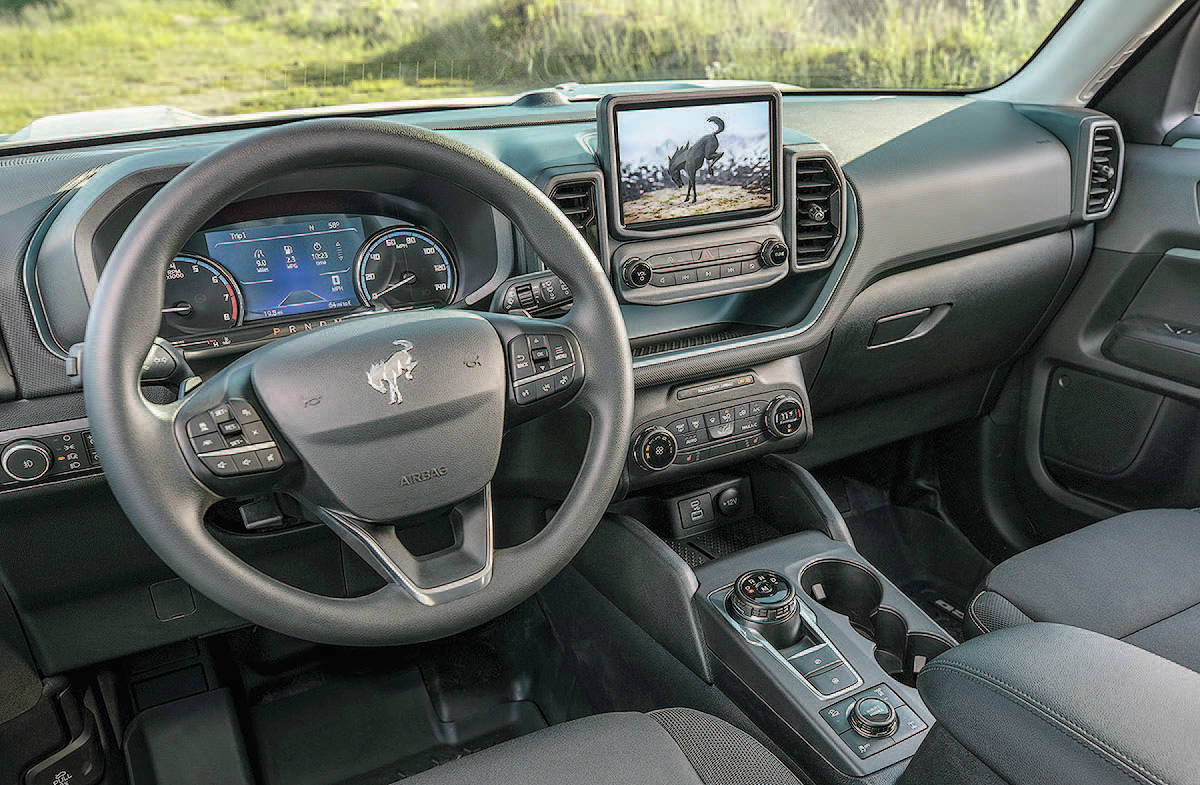 The squared-off exterior styling extends into the interior, where an eight-inch touch-screen is perched upright above the ventilation controls. The floor console is home to a gear-selector knob that replaces the traditional shift lever. PHOTO: FORD