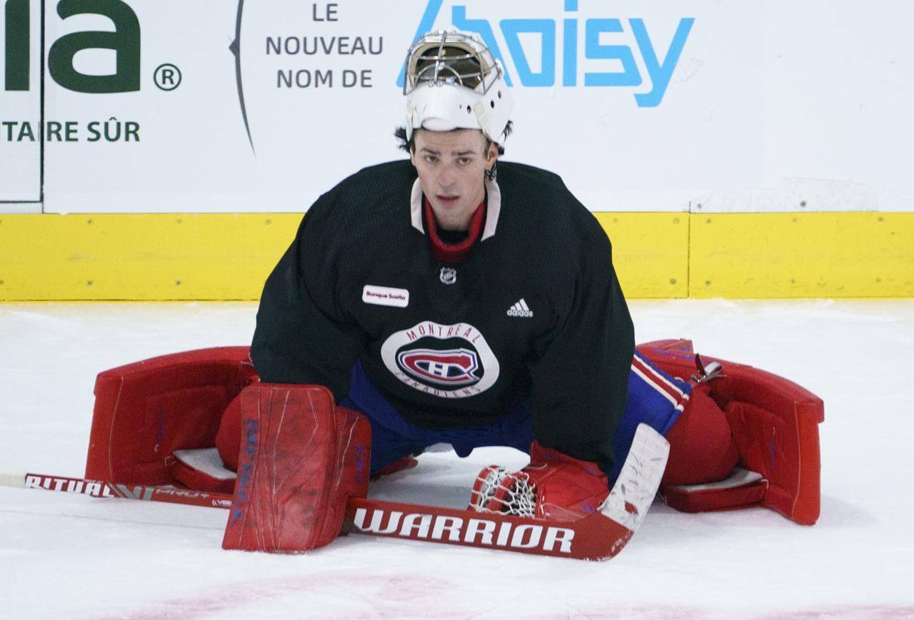 Montreal Canadiens goaltender Carey Price stretches during the first team practice in Brossard, Que. on Monday, January 4, 2021. THE CANADIAN PRESS/Paul Chiasson