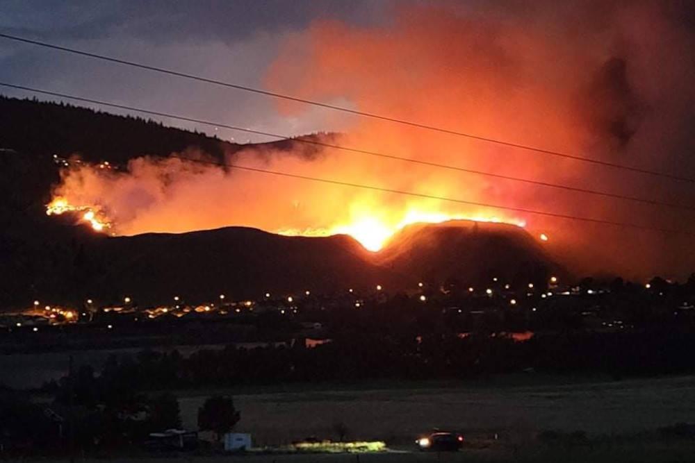 A lightning-caused wildfire in Kamloops' Juniper Ridge neighbourhood on July 1, 2021. (@sarah_sandholm/Twitter)A lightning-caused wildfire in Kamloops' Juniper Ridge neighbourhood on July 1, 2021. (@sarah_sandholm/Twitter)