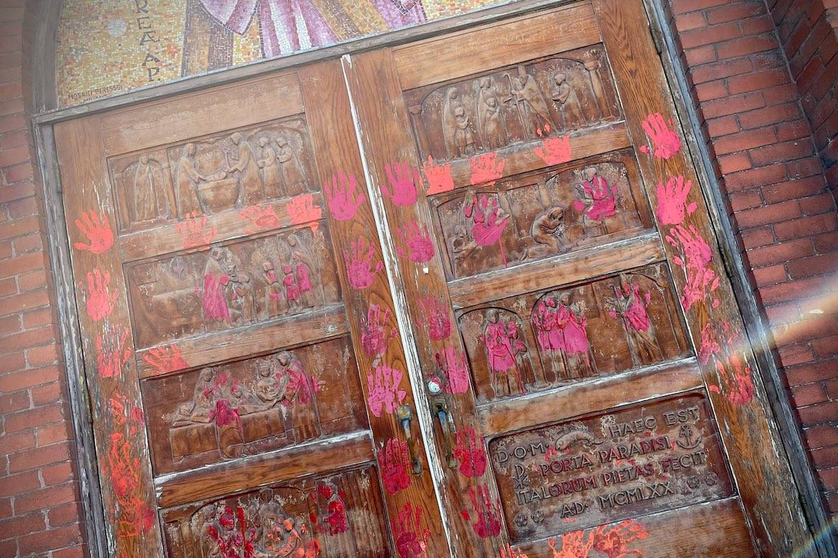 Police say ten churches in Calgary were vandalized with red and orange paint — acts investigators believe are a response to the recent discoveries of unmarked graves at the sites of former residential schools. (Twitter/Jason Kenney)