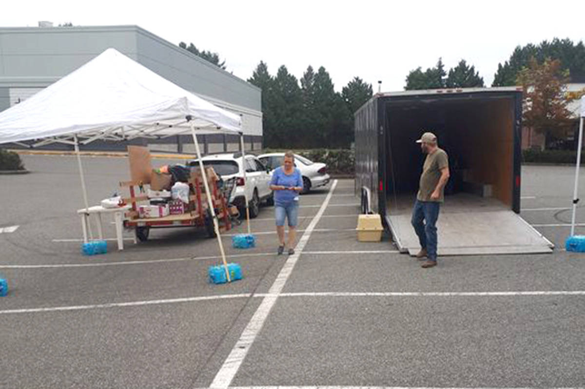 A team of volunteers outside of FreshCo in Aldergrove are collecting donations for the displaced wildfire victims of Lytton. (Special to The Star)