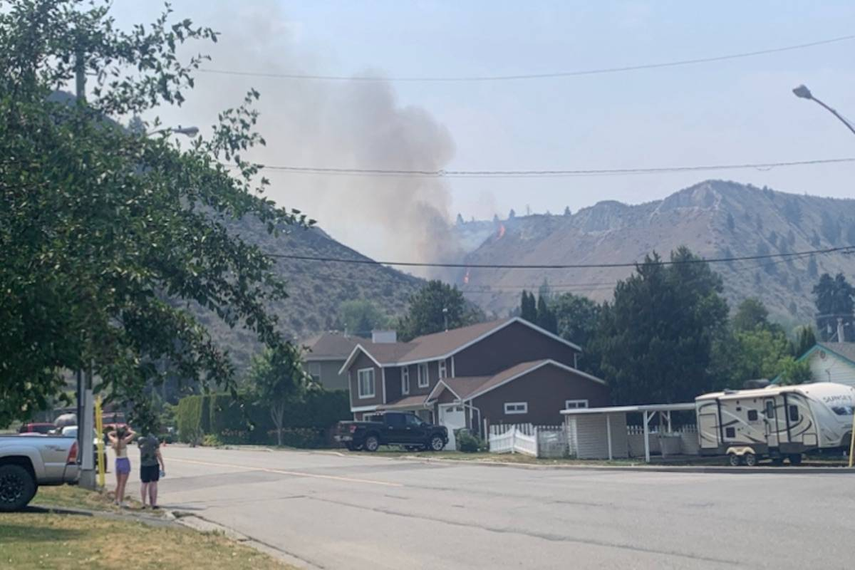 Crews are working to extinguish flames on July 2, 2021, as the fire between Valleyview and Juniper Ridge has flared up again. The blaze was ignited by lightning on the night of July 1. Photograph By JESSICA WALLACE/KTW