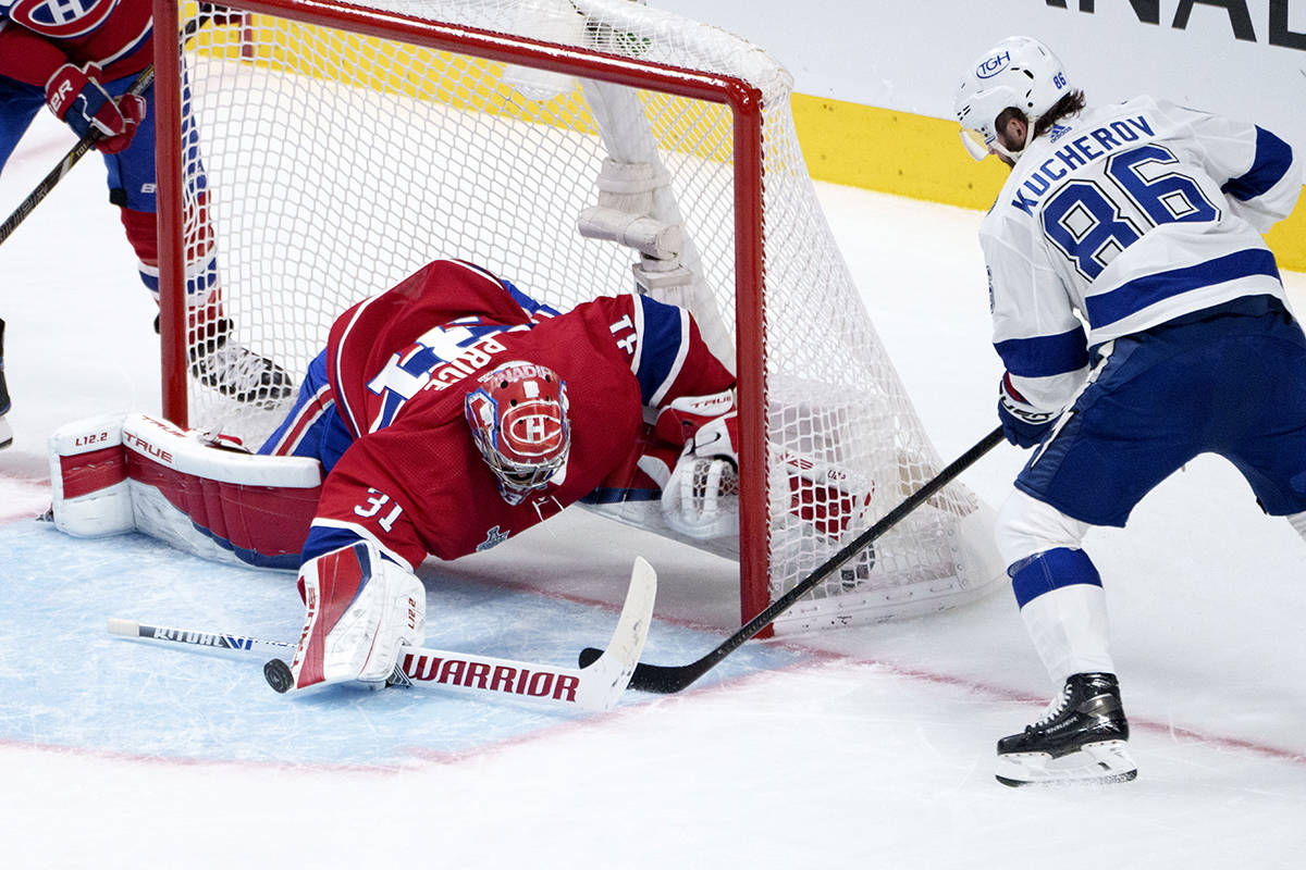Montreal Canadiens goaltender Carey Price makes a save off Tampa Bay Lightning's Nikita Kucherov during second period Game 3 Stanley Cup finals action in Montreal, Friday, July 2, 2021. THE CANADIAN PRESS/Paul Chiasson