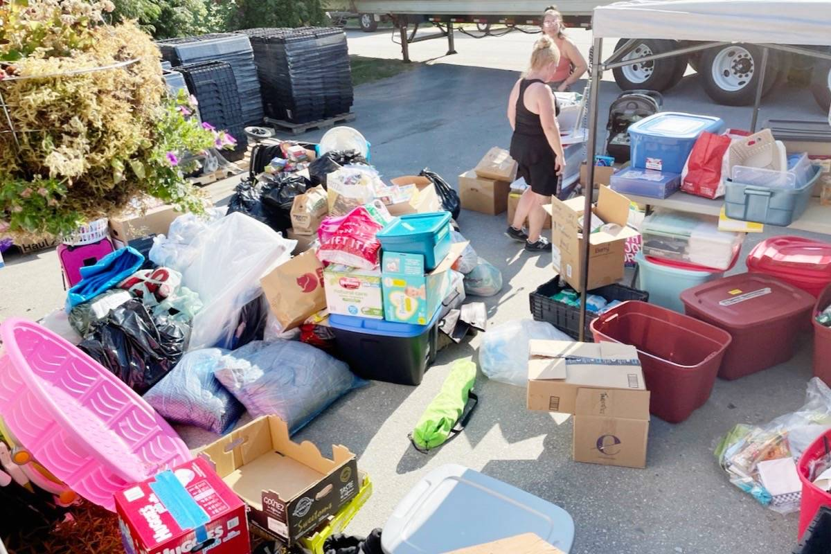 Volunteers sort through donations for the fire victims of Lytton. (Katzie First Nation/Special to the News)