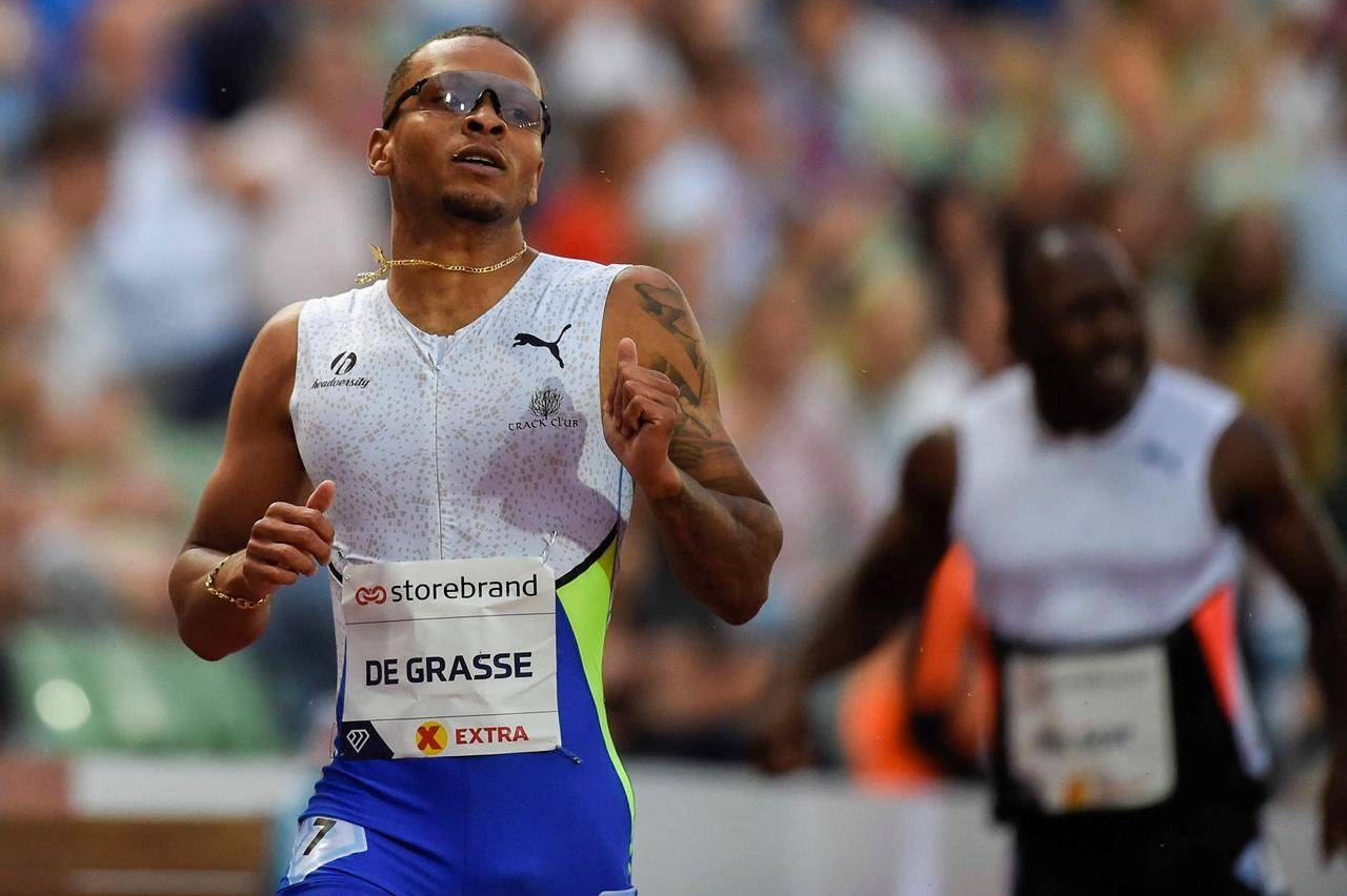 André De Grasse, of Canada, wins the men's 200m at the Diamond League meeting in Oslo, Norway, Thursday, July 1, 2021. De Grasse had to train on a soccer field for weeks after his track in Florida closed for COVID-19 protocols. THE CANADIAN PRESS/AP-NTB, Annika Byrd