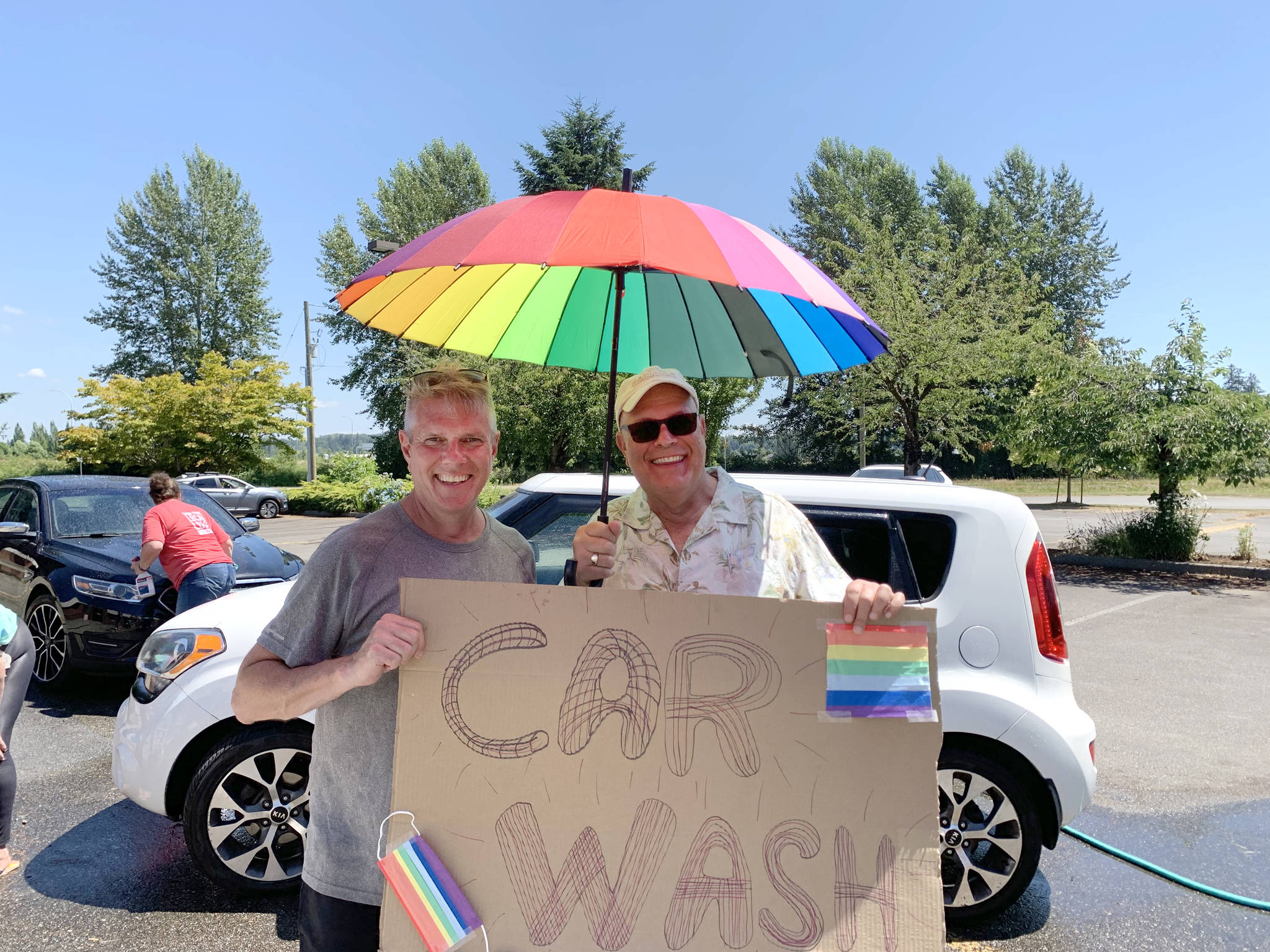 Liberal candidate for Cloverdale-Langley City John Aldag (grey T-shirt) hosted a car wash fundraiser in support of Langley Pride, One TWU, and Youth for a Change on Saturday, July 3, 2021 at St. Andrew's Anglican Church in Langley City. (John Aldag/Special to Langley Advance Times)