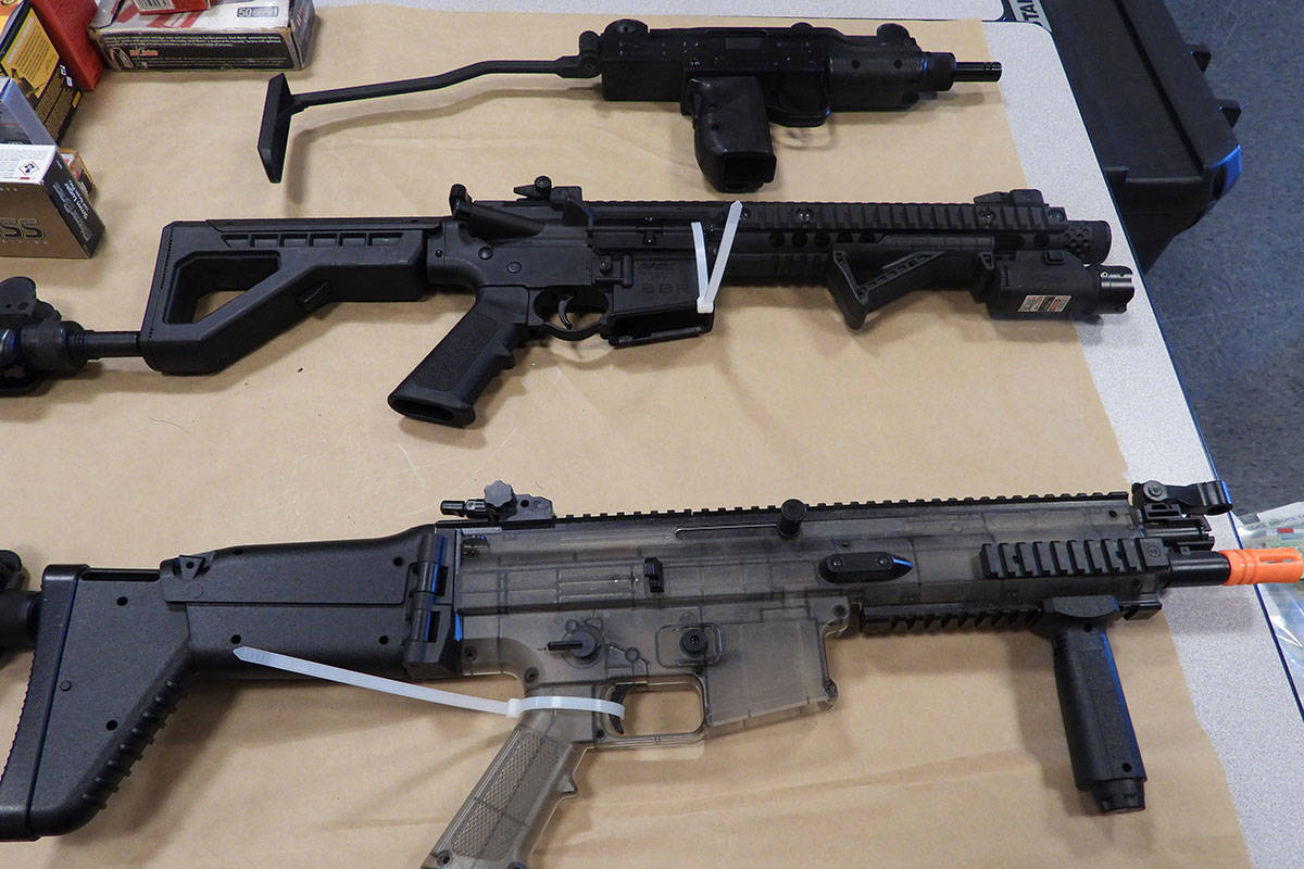 Surrey RCMP seized a number of guns that were allegedly connected to a Langley shop suspected of illegally selling cannabis. (RCMP handout)