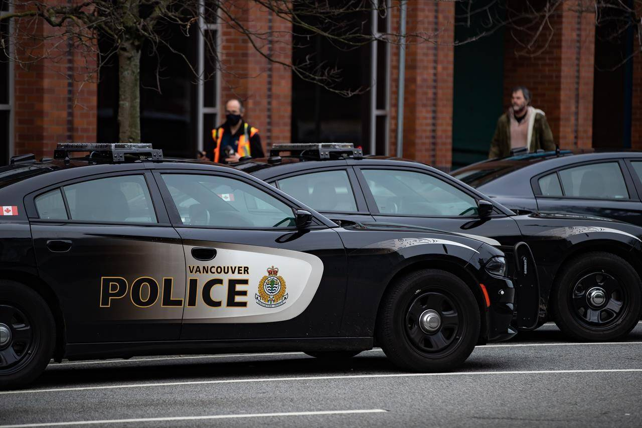 Police cars are seen parked outside Vancouver Police Department headquarters in Vancouver, on Saturday, January 9, 2021. THE CANADIAN PRESS/Darryl Dyck
