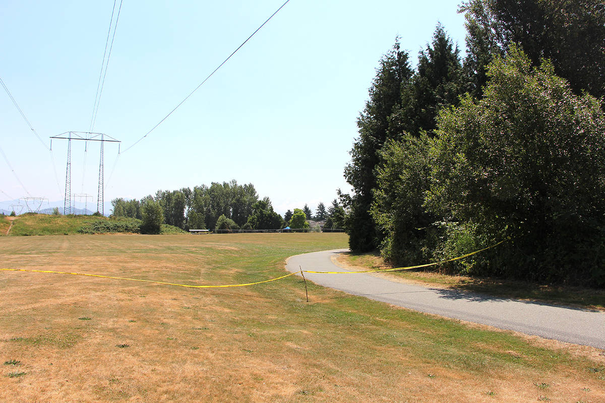 A large portion of Clearbrook Park in Abbotsford has been taped off following the discovery of a body on Monday mroning (July 5). (Vikki Hopes/Abbotsford News)