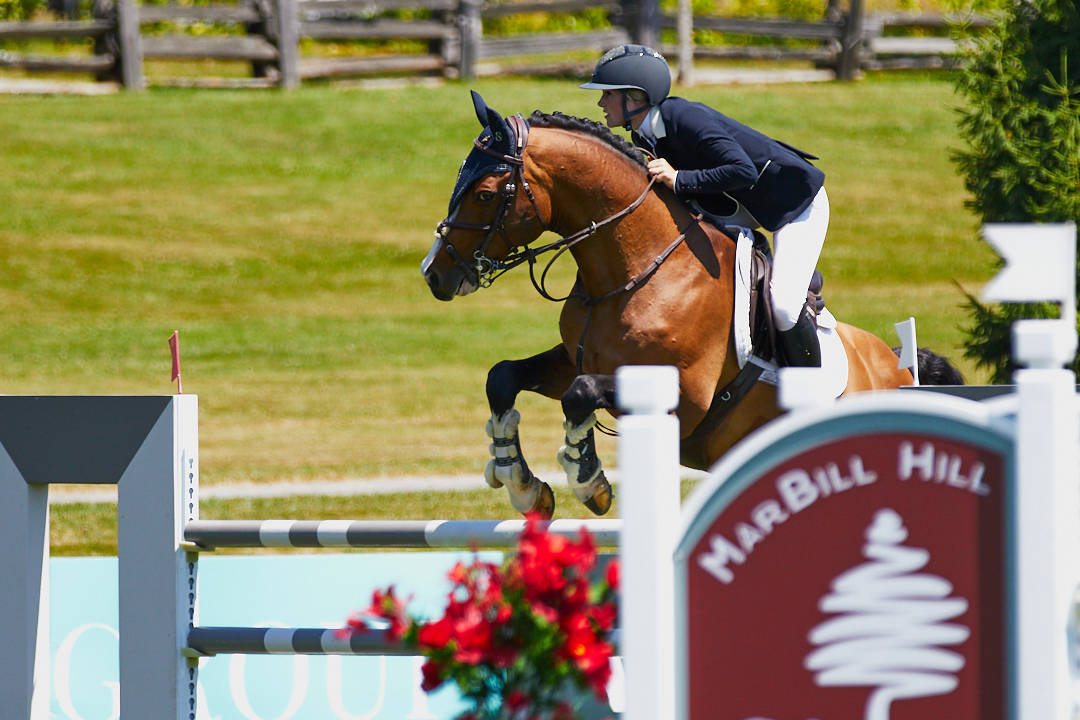 """Ashley Arnoldt and """"Lestat Old"""" took the top prize of $15,000 in the MarBill Hill U25 League 1.40m class at Thunderbird Show Park on Sunday, July 4, 2021. (Rob Wilton/RJMedia Photography)"""