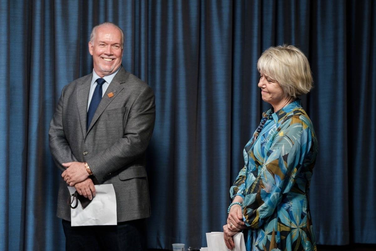 B.C. Premier John Horgan congratulates provincial health officer Dr. Bonnie Henry on her management of the COVID-19 pandemic as restrictions are about to lift, June 30, 2021. (B.C. government photo)
