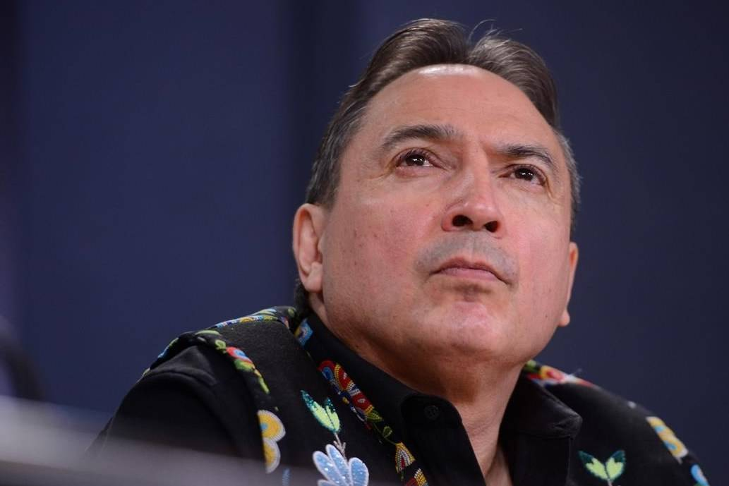 Assembly of First Nations (AFN) National Chief Perry Bellegarde is joined by First Nations leaders as they discuss the current situation and actions relating to the Wet'suwet'en hereditary chiefs during a press conference at the National Press Theatre in Ottawa on February 18, 2020. THE CANADIAN PRESS/Sean Kilpatrick