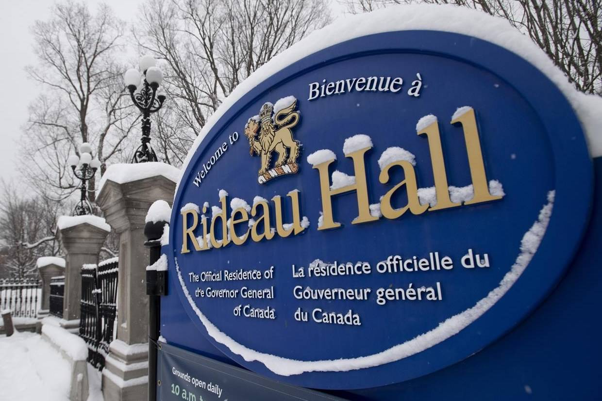 A sign along the wall surrounding Rideau Hall is shown Thursday January 21, 2021 in Ottawa. THE CANADIAN PRESS/Adrian Wyld
