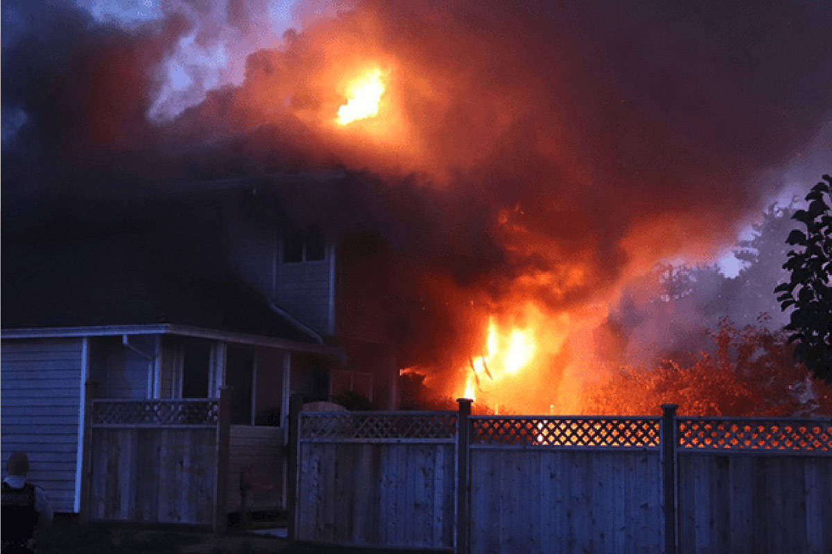 A house in Fleetwood goes up in flames Monday night. The home at 94th Avenue and 154A Street became a crime scene after one victim was taken to hospital with undetermined injuries. (Photos: Shane MacKichan)