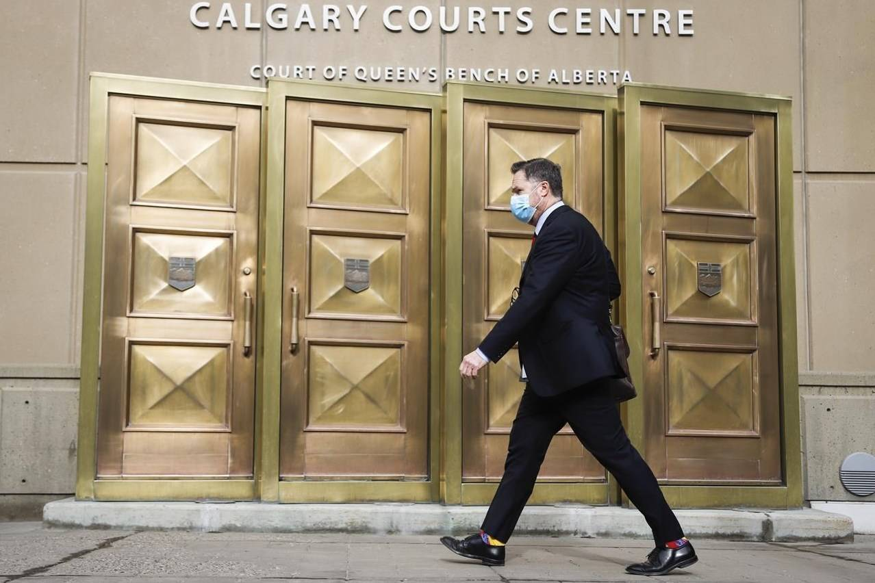 A man wears a mask as he enters the Calgary Courts Centre during COVID-19 restrictions in Calgary on May 17, 2021. THE CANADIAN PRESS/Jeff McIntosh