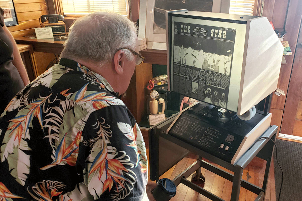 Kurt Langmann viewing the Aldergrove Star microfilm from August 1967 - his very first published front page photo, taken at the Abbotsford Air Show. (Scott White/Special to The Star)