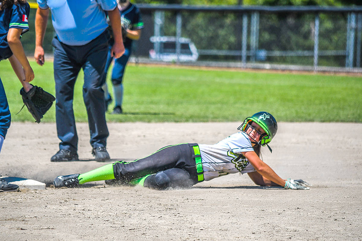 Smiling into second, Makenna Adler-Bock secured her spot on the base with a picture-perfect slide. (Special to Langley Advance Times)