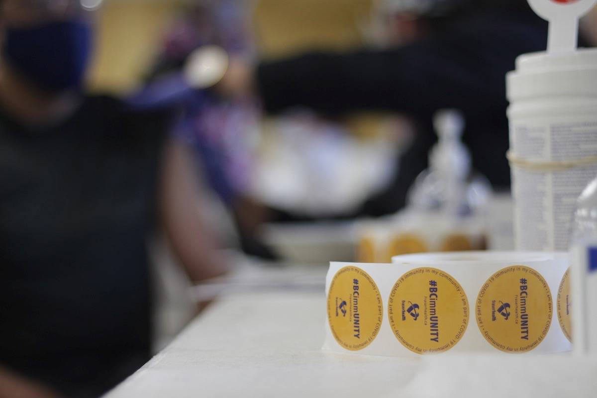Stickers are distributed at a COVID-19 vaccine clinic at Gurdwara Dukh Nivaran Sahib in Surrey May 7, 2021. (Lauren Collins/Surrey Nowleader)