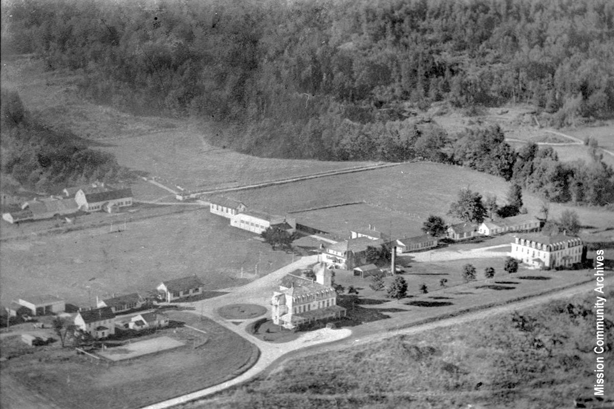 A 1957 aerial photo of St. Mary's Residential School at Fraser River Heritage Park in Mission. Several years later the buildings would be demolished after the new school built in 1960. Mission Community Archives photo.
