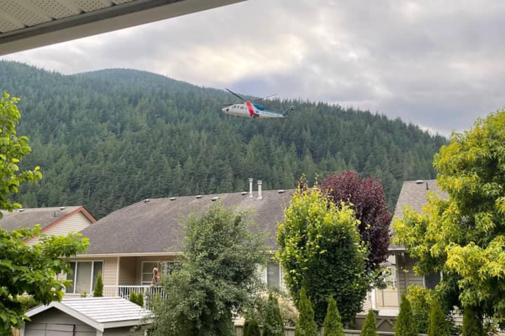 An air ambulance hovers over Harrison Hot Springs as medics respond to reports of a two-year-old drowning in a hot tub. Thanks to the quick action of emergency responders, two toddlers were saved from drowning last week. (Photo/Caprice Schweda)