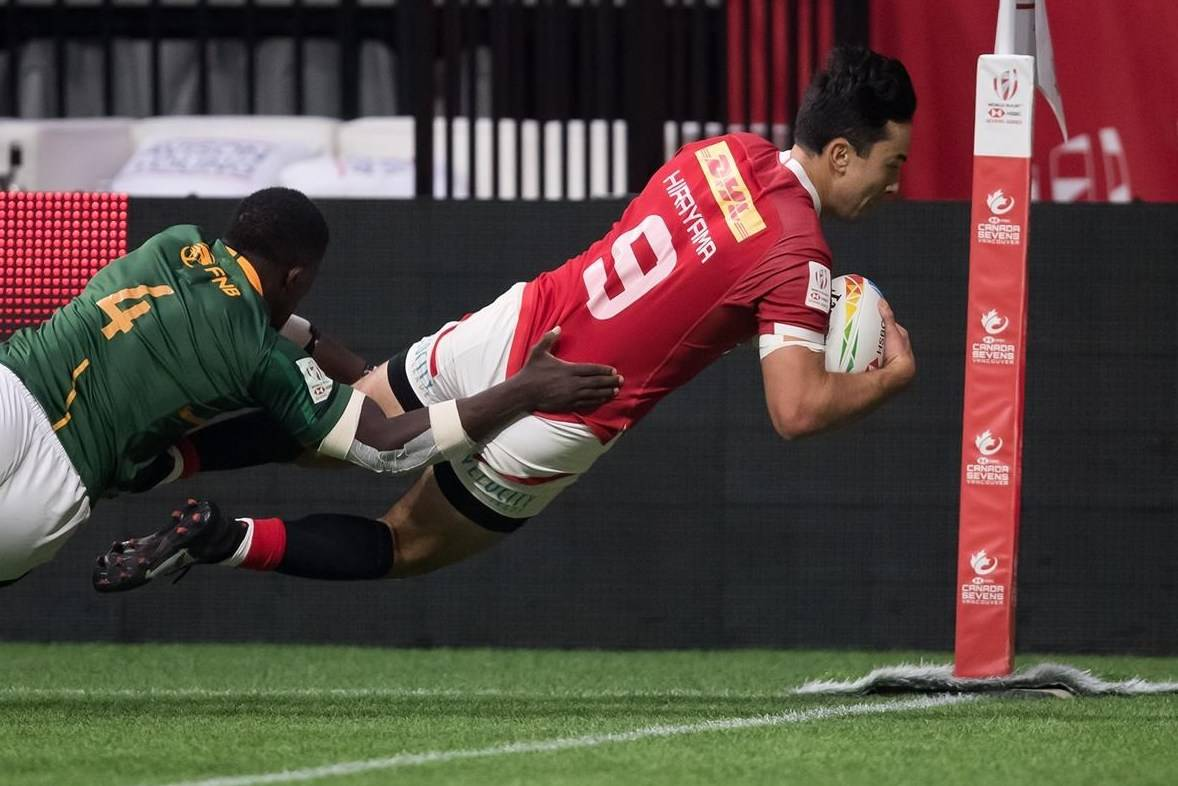 Canada's Nathan Hirayama, right, dives to score a try in front of South Africa's Sakoyisa Makata during the bronze medal match at the Canada Sevens rugby tournament in Vancouver, on Sunday, March 8, 2020. The Canadian men's rugby sevens team will land in the the deep end at Tokyo Olympics, opening against Rio 2016 runner-up Britain before facing defending Olympic champion Fiji.THE CANADIAN PRESS/Darryl Dyck